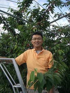 生産者である小山さんの写真